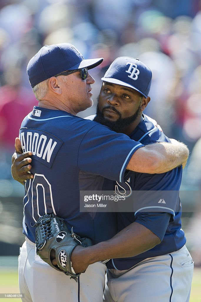 Manager <a gi-track='captionPersonalityLinkClicked' href=/galleries/search?phrase=Joe+Maddon&family=editorial&specificpeople=568433 ng-click='$event.stopPropagation()'>Joe Maddon</a> #70 congratulates closing pitcher George Hendrick #25 of the Tampa Bay Rays after the Rays defeated the Cleveland Indians at Progressive Field on July 8, 2012 in Cleveland, Ohio. The Rays defeated the Indians 7-6.