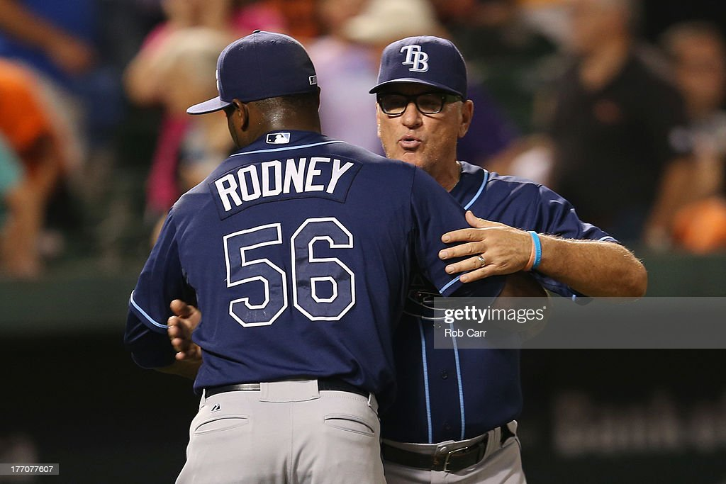 Manager <a gi-track='captionPersonalityLinkClicked' href=/galleries/search?phrase=Joe+Maddon&family=editorial&specificpeople=568433 ng-click='$event.stopPropagation()'>Joe Maddon</a> hugs pitcher <a gi-track='captionPersonalityLinkClicked' href=/galleries/search?phrase=Fernando+Rodney&family=editorial&specificpeople=547291 ng-click='$event.stopPropagation()'>Fernando Rodney</a> #56 of the Tampa Bay Rays after the Rays defeated the Baltimore Orioles 7-4 at Oriole Park at Camden Yards on August 20, 2013 in Baltimore, Maryland.