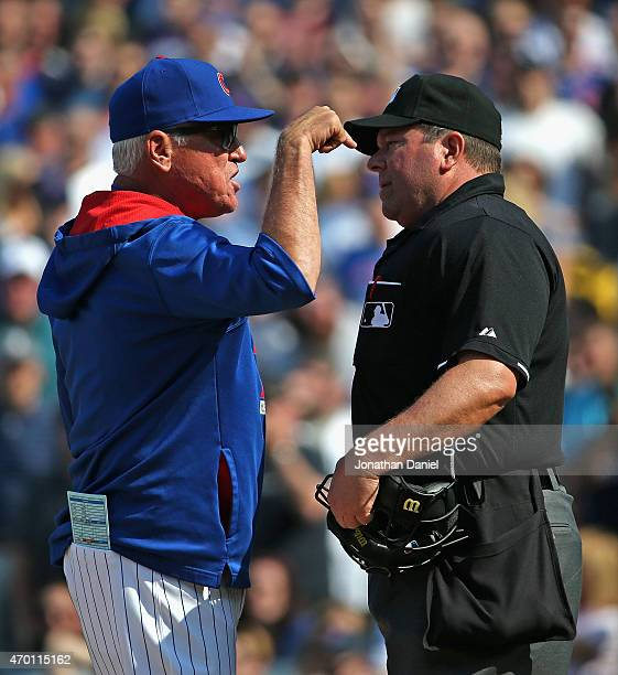 Manager Joe Maddon of the Chicago Cubs argues with home plate umpire Sam Holbrook after being thrown out of a game against the San Diego Padres at...