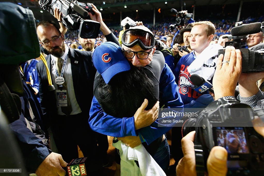 Manager Joe Maddon of the Chicago Cubs celebrates with his wife Jaye Sousoures after defeating the Los Angeles Dodgers 5-0 in game six of the National League Championship Series to advance to the World Series against the Cleveland Indians at Wrigley Field on October 22, 2016 in Chicago, Illinois.