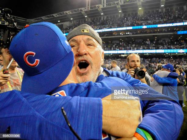 Manager Joe Maddon of the Chicago Cubs embraces pinch runner Chris Coghlan after winning Game 7 of the World Series against the Cleveland Indians on...