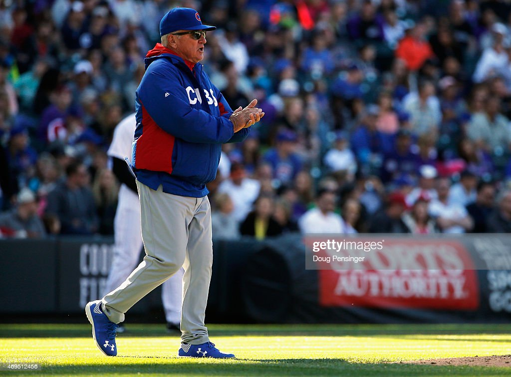 Manager Joe Maddon #70 of the Chicago Cubs heads to the mound to make a pitching change against the Colorado Rockies at Coors Field on April 12, 2015 in Denver, Colorado. The Cubs defeated the Rockies 6-5.