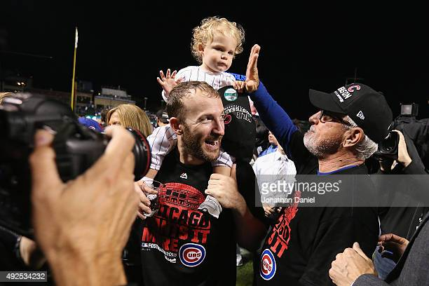 Manager Joe Maddon of the Chicago Cubs high fives the daughter of Chris Denorfia of the Chicago Cubs after the Chicago Cubs defeat the St Louis...