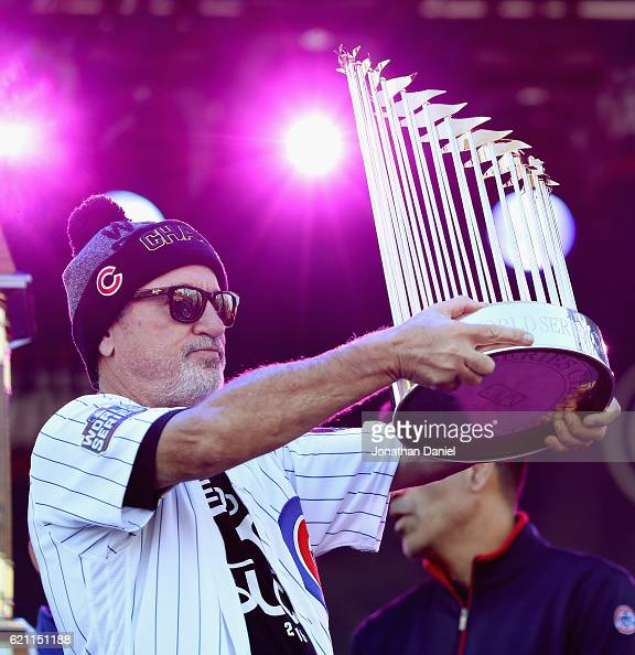 Manager Joe Maddon of the Chicago Cubs holds the World Series trophy during the Chicago Cubs victory celebration in Grant Park on November 4 2016 in...