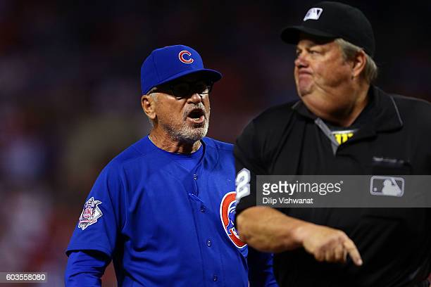 Manager Joe Maddon of the Chicago Cubs is ejected from the game in the ninth inning by umpire Joe West at against the St Louis Cardinals Busch...