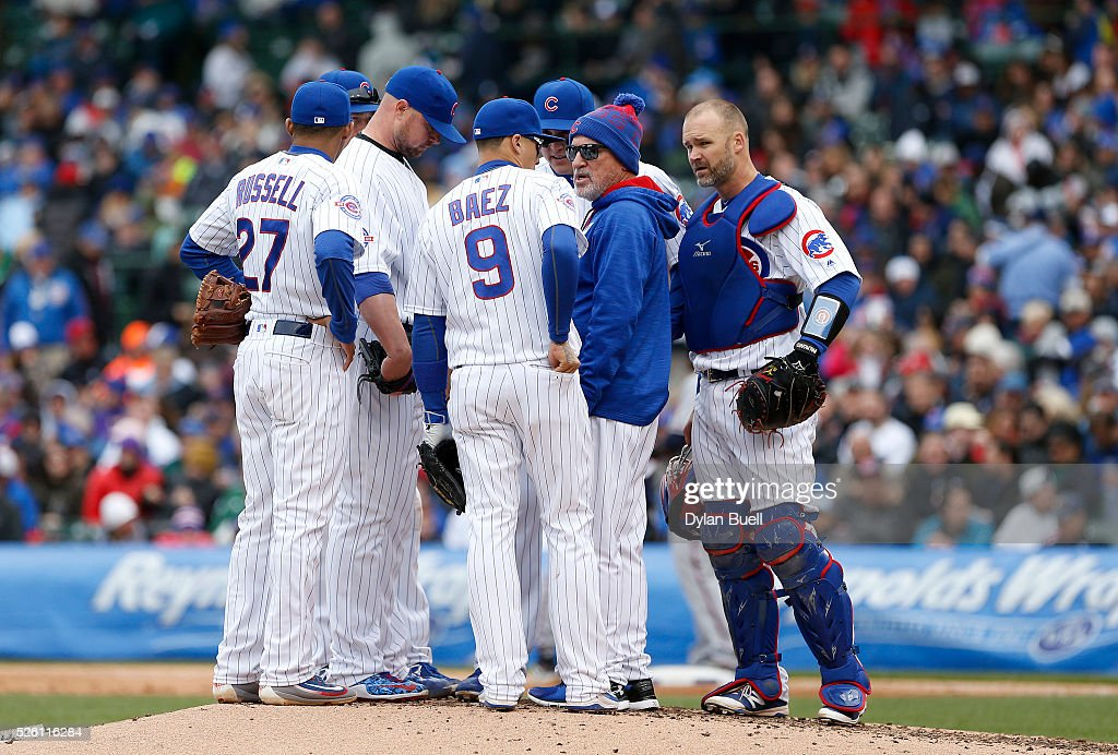 Manager <a gi-track='captionPersonalityLinkClicked' href=/galleries/search?phrase=Joe+Maddon&family=editorial&specificpeople=568433 ng-click='$event.stopPropagation()'>Joe Maddon</a> of the Chicago Cubs makes a visit to the mound in the seventh inning against the Atlanta Braves at Wrigley Field on April 29, 2016 in Chicago, Illinois.