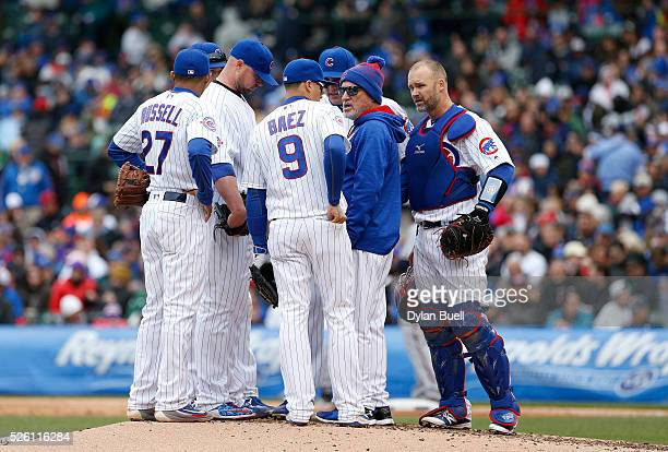 Manager Joe Maddon of the Chicago Cubs makes a visit to the mound in the seventh inning against the Atlanta Braves at Wrigley Field on April 29 2016...