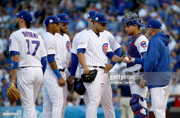 Manager Joe Maddon of the Chicago Cubs relieves Jose Quintana in the sixth inning against the Washington Nationals during game three of the National...
