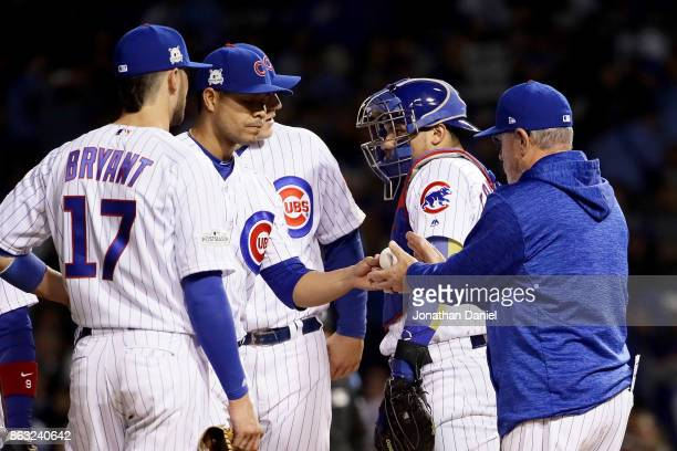 Manager Joe Maddon of the Chicago Cubs relieves Jose Quintana in the third inning against the Los Angeles Dodgers during game five of the National...