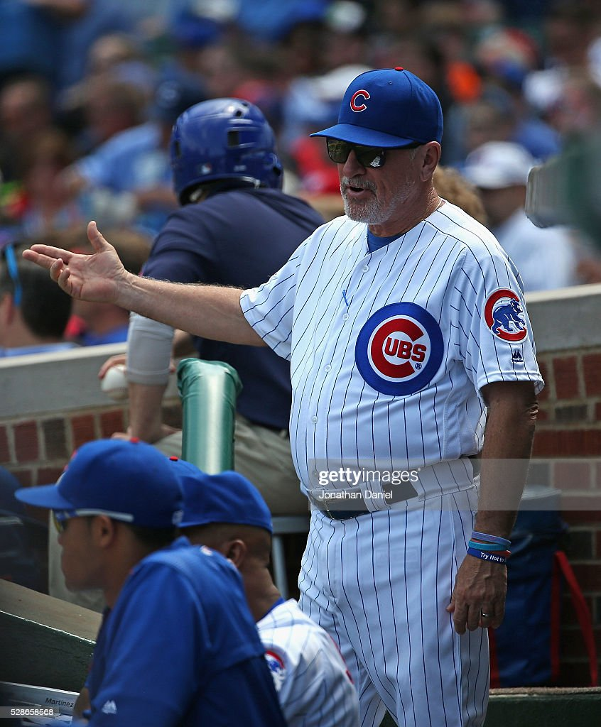 Manager Joe Maddon #70 of the Chicago Cubs talks with coaches in the dugout during a game against the Washington Nationals at Wrigley Field on May 6, 2016 in Chicago, Illinois.