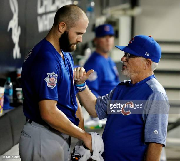 Manager Joe Maddon of the Chicago Cubs talks with Jake Arrieta after taking him out of the game against the Chicago White Sox during the seventh...