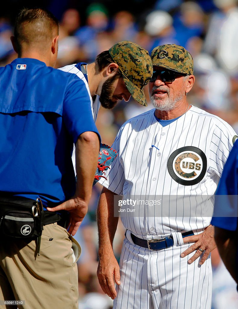 Manager <a gi-track='captionPersonalityLinkClicked' href=/galleries/search?phrase=Joe+Maddon&family=editorial&specificpeople=568433 ng-click='$event.stopPropagation()'>Joe Maddon</a> #70 of the Chicago Cubs talks with <a gi-track='captionPersonalityLinkClicked' href=/galleries/search?phrase=Jason+Hammel+-+Baseball+Player&family=editorial&specificpeople=7902991 ng-click='$event.stopPropagation()'>Jason Hammel</a> #39 after he sustained an injury before the start of th ethird inning during the game against the Los Angeles Dodgers at Wrigley Field on May 30, 2016 in Chicago, Illinois.