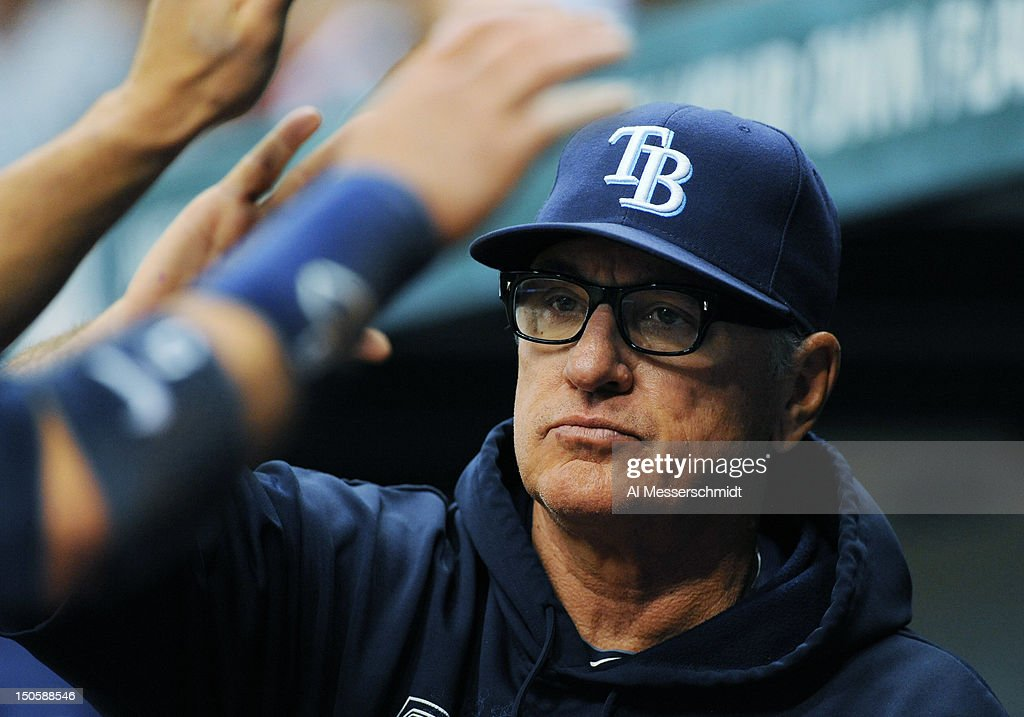 Manager <a gi-track='captionPersonalityLinkClicked' href=/galleries/search?phrase=Joe+Maddon&family=editorial&specificpeople=568433 ng-click='$event.stopPropagation()'>Joe Maddon</a> of the Tampa Bay Rays applauds a score against the Kansas City Royals August 22, 2012 at Tropicana Field in St. Petersburg, Florida. The Rays won 5 - 3.