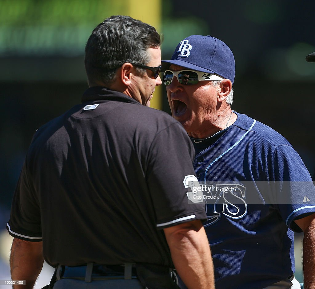 Manager Joe Maddon of the Tampa Bay Rays argues with home plate umpire Rob Drake after being ejected for complaining about the strike zone in the...
