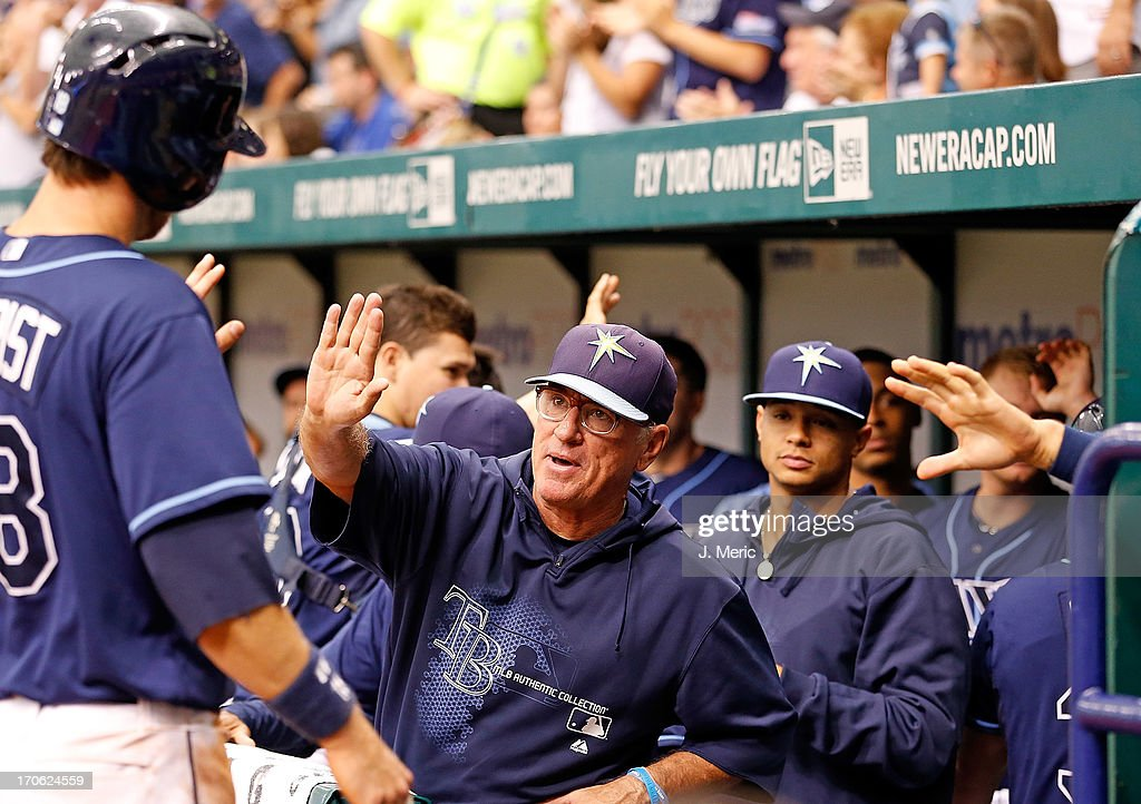 Manager Joe Maddon #70 of the Tampa Bay Rays congratulates Ben Zobrist #18 after scoring against the Kansas City Royals during the game at Tropicana Field on June 15, 2013 in St. Petersburg, Florida.