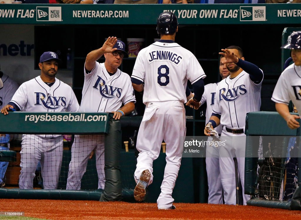 Manager <a gi-track='captionPersonalityLinkClicked' href=/galleries/search?phrase=Joe+Maddon&family=editorial&specificpeople=568433 ng-click='$event.stopPropagation()'>Joe Maddon</a> #70 of the Tampa Bay Rays congratulates <a gi-track='captionPersonalityLinkClicked' href=/galleries/search?phrase=Desmond+Jennings&family=editorial&specificpeople=5974085 ng-click='$event.stopPropagation()'>Desmond Jennings</a> #8 after he scored a first inning run against the Arizona Diamondbacks during the game at Tropicana Field on July 30, 2013 in St. Petersburg, Florida.