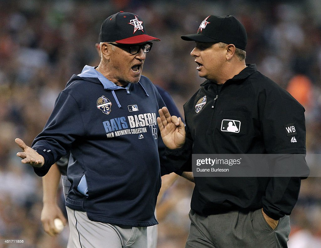 Manager <a gi-track='captionPersonalityLinkClicked' href=/galleries/search?phrase=Joe+Maddon&family=editorial&specificpeople=568433 ng-click='$event.stopPropagation()'>Joe Maddon</a> #70 of the Tampa Bay Rays continues to argue with second base umpire <a gi-track='captionPersonalityLinkClicked' href=/galleries/search?phrase=Greg+Gibson&family=editorial&specificpeople=228434 ng-click='$event.stopPropagation()'>Greg Gibson</a> after being ejected from the game during the sixth inning at Comerica Park on July 4, 2014 in Detroit, Michigan. Maddon was tossed while protesting the warning Gibson gave to both teams after Ian Kinsler of the Detroit Tigers was hit with a pitch.