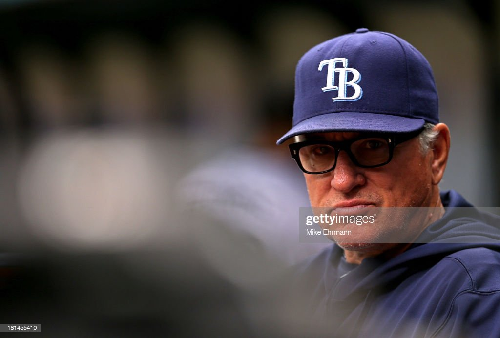 Manager <a gi-track='captionPersonalityLinkClicked' href=/galleries/search?phrase=Joe+Maddon&family=editorial&specificpeople=568433 ng-click='$event.stopPropagation()'>Joe Maddon</a> #70 of the Tampa Bay Rays looks on during a game against the Baltimore Orioles at Tropicana Field on September 21, 2013 in St Petersburg, Florida.