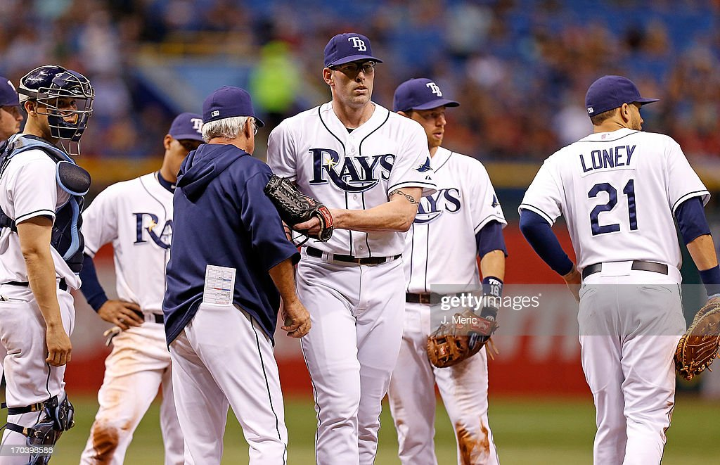 Manager Joe Maddon #70 of the Tampa Bay Rays makes a pitching change in the sixth inning against the Boston Red Sox at Tropicana Field on June 12, 2013 in St. Petersburg, Florida.