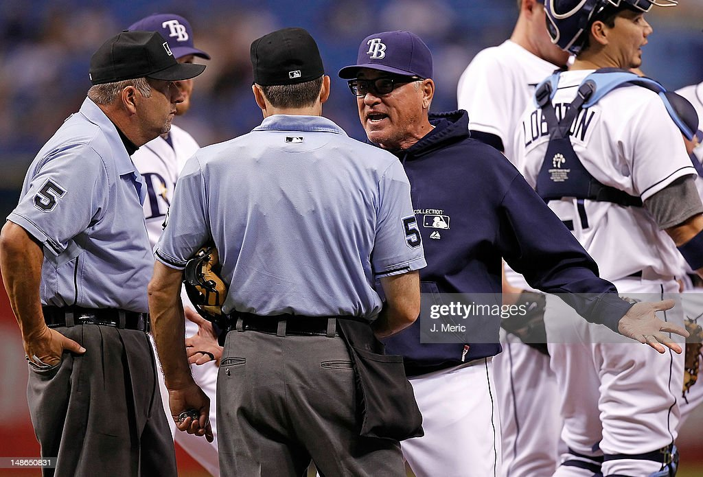 Manager <a gi-track='captionPersonalityLinkClicked' href=/galleries/search?phrase=Joe+Maddon&family=editorial&specificpeople=568433 ng-click='$event.stopPropagation()'>Joe Maddon</a> #70 of the Tampa Bay Rays pleads with homeplate umpire Dan Iassogna after he is ejected against the Cleveland Indians during the game at Tropicana Field on July 18, 2012 in St. Petersburg, Florida.