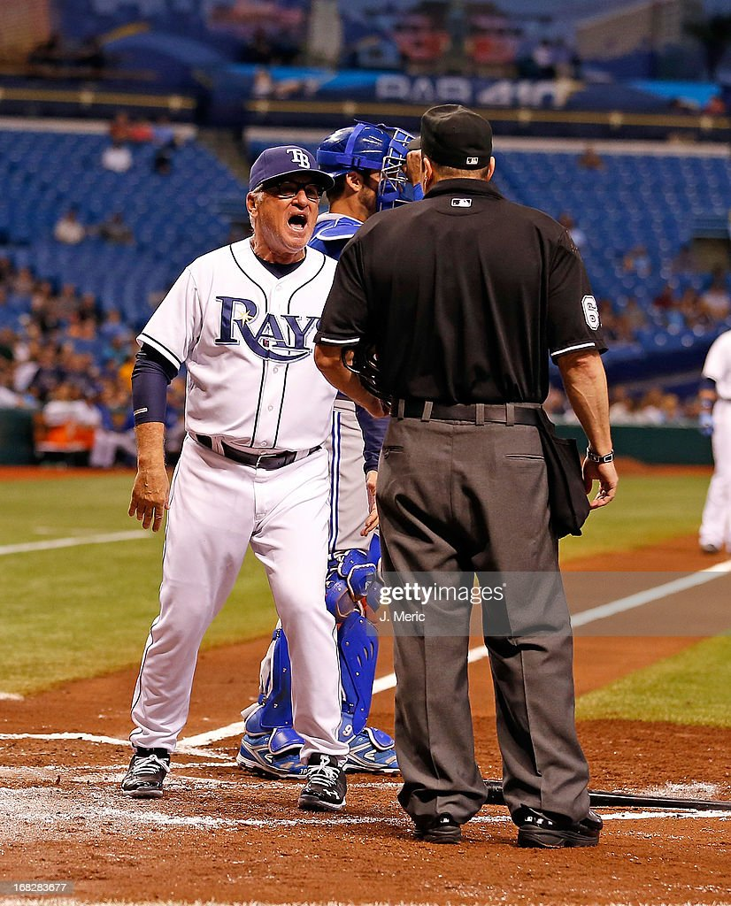 Manager <a gi-track='captionPersonalityLinkClicked' href=/galleries/search?phrase=Joe+Maddon&family=editorial&specificpeople=568433 ng-click='$event.stopPropagation()'>Joe Maddon</a> #70 of the Tampa Bay Rays questions the call of homeplate umpire Marty Foster #60 during the game against the Toronto Blue Jays at Tropicana Field on May 7, 2013 in St. Petersburg, Florida. Maddon was ejected in this exchange.