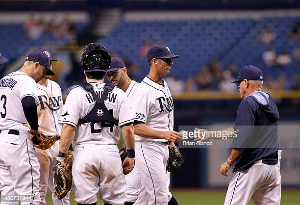 Manager Joe Maddon of the Tampa Bay Rays takes pitcher Grant Balfour Rays out of the game during the eighth inning against the Baltimore Orioles on...