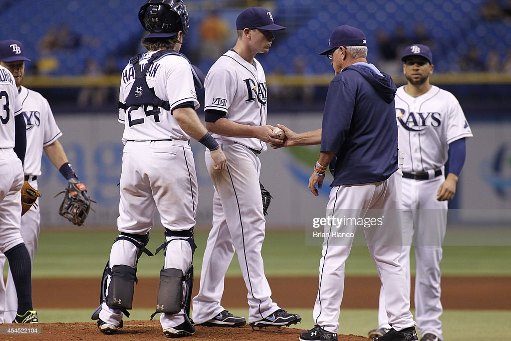 Manager <a gi-track='captionPersonalityLinkClicked' href=/galleries/search?phrase=Joe+Maddon&family=editorial&specificpeople=568433 ng-click='$event.stopPropagation()'>Joe Maddon</a> #70 of the Tampa Bay Rays takes pitcher <a gi-track='captionPersonalityLinkClicked' href=/galleries/search?phrase=Jeremy+Hellickson&family=editorial&specificpeople=2364859 ng-click='$event.stopPropagation()'>Jeremy Hellickson</a> #58 of the Tampa Bay Rays out of the game after giving up a three-run home run to Jose Reyes of the Toronto Blue Jays during the fourth inning of a game on September 2, 2014 at Tropicana Field in St. Petersburg, Florida.
