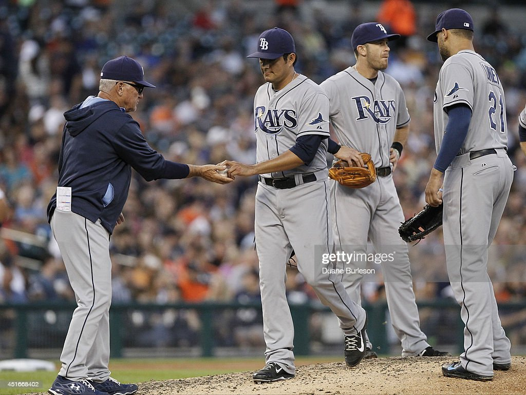 Manager <a gi-track='captionPersonalityLinkClicked' href=/galleries/search?phrase=Joe+Maddon&family=editorial&specificpeople=568433 ng-click='$event.stopPropagation()'>Joe Maddon</a> #70 of the Tampa Bay Rays takes the ball from Cesar Ramos #27 during the sixth inning as third baseman <a gi-track='captionPersonalityLinkClicked' href=/galleries/search?phrase=Evan+Longoria&family=editorial&specificpeople=2349329 ng-click='$event.stopPropagation()'>Evan Longoria</a> #3 and first baseman <a gi-track='captionPersonalityLinkClicked' href=/galleries/search?phrase=James+Loney&family=editorial&specificpeople=636293 ng-click='$event.stopPropagation()'>James Loney</a> #21 wait on the mound during a game against the Detroit Tigers at Comerica Park on July 3, 2014 in Detroit, Michigan. The Tigers defeated the Rays 8-1.