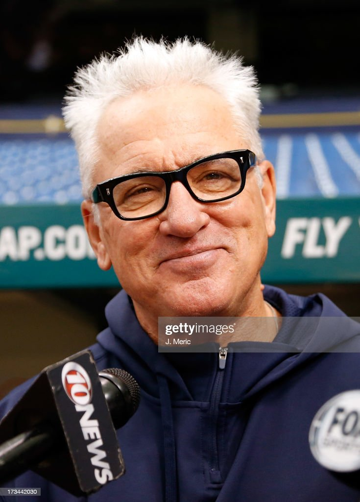 Manager Joe Maddon #70 of the Tampa Bay Rays talks with the media just before the start of the game against the Houston Astros at Tropicana Field on July 14, 2013 in St. Petersburg, Florida.