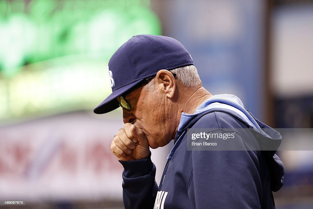 Manager <a gi-track='captionPersonalityLinkClicked' href=/galleries/search?phrase=Joe+Maddon&family=editorial&specificpeople=568433 ng-click='$event.stopPropagation()'>Joe Maddon</a> #70 of the Tampa Bay Rays walks out to take pitcher Joel Peralta #62 of the Tampa Bay Rays off the mound during the during the seventh inning of a game against the Cleveland Indians on May 9, 2014 at Tropicana Field in St. Petersburg, Florida.