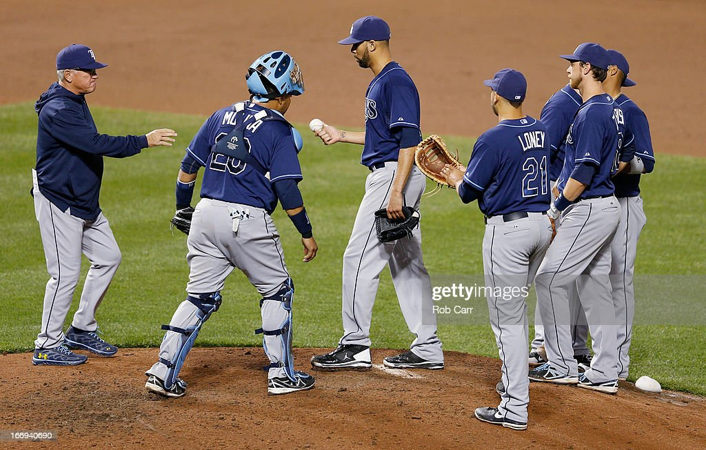 Manager <a gi-track='captionPersonalityLinkClicked' href=/galleries/search?phrase=Joe+Maddon&family=editorial&specificpeople=568433 ng-click='$event.stopPropagation()'>Joe Maddon</a> removes starting pitcher <a gi-track='captionPersonalityLinkClicked' href=/galleries/search?phrase=David+Price+-+Jugador+de+b%C3%A9isbol&family=editorial&specificpeople=4961936 ng-click='$event.stopPropagation()'>David Price</a> #14 of the Tampa Bay Rays from the game against the Baltimore Orioles during the seventh inning of the Orioles 10-6 win at Oriole Park at Camden Yards on April 18, 2013 in Baltimore, Maryland.