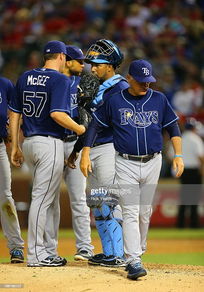 Manager <a gi-track='captionPersonalityLinkClicked' href=/galleries/search?phrase=Joe+Maddon&family=editorial&specificpeople=568433 ng-click='$event.stopPropagation()'>Joe Maddon</a> #70 returns to the dugout after relieving Roberto Hernandez #40 for <a gi-track='captionPersonalityLinkClicked' href=/galleries/search?phrase=Jake+McGee+-+Baseball+Player&family=editorial&specificpeople=15096866 ng-click='$event.stopPropagation()'>Jake McGee</a> #57 of the Tampa Bay Rays in the seventh inning against the Texas Rangers at Rangers Ballpark in Arlington on April 9, 2013 in Arlington, Texas.