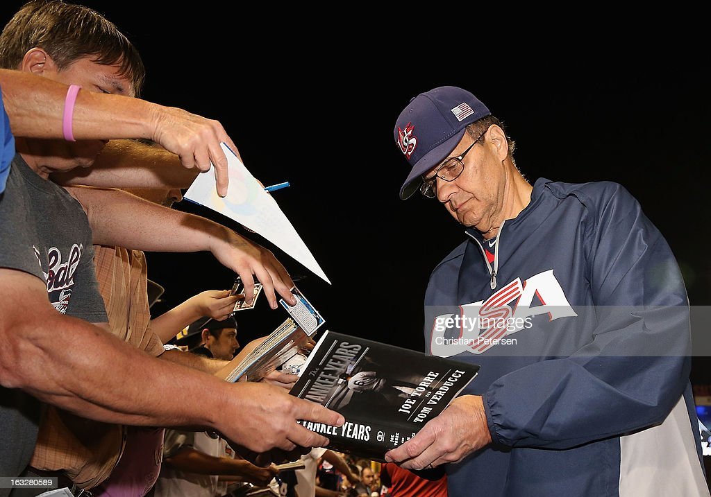 Manager Joe Torre of Team USA signs autographs for fans before the spring training game against the Colorado Rockies at Salt River Fields at Talking Stick on March 6, 2013 in Scottsdale, Arizona.