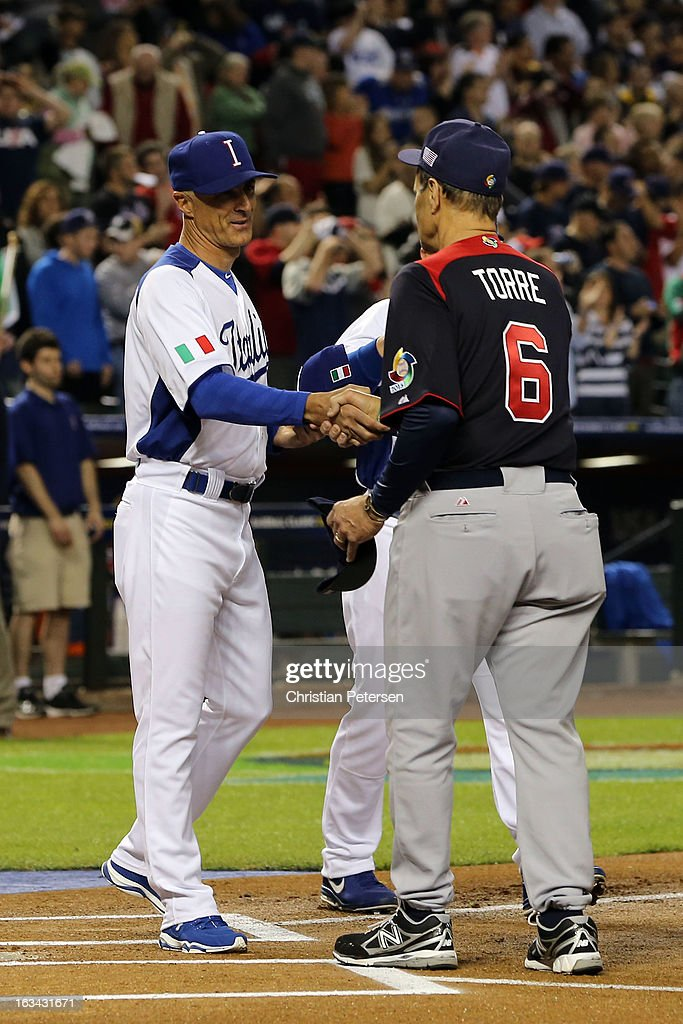 Manager <a gi-track='captionPersonalityLinkClicked' href=/galleries/search?phrase=Joe+Torre&family=editorial&specificpeople=204583 ng-click='$event.stopPropagation()'>Joe Torre</a> (R) of USA shakes hands with manager Marco Mazzieri (L) of Itay prior to the World Baseball Classic First Round Group D game at Chase Field on March 9, 2013 in Phoenix, Arizona.