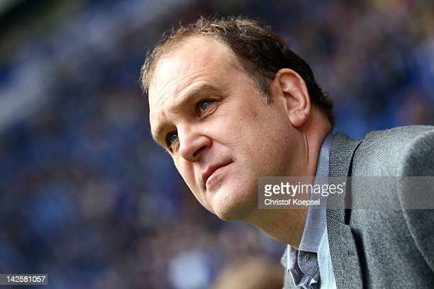 Manager Joer Schmadtke of Hannover looks dejected prior to the Bundesliga match between FC Schalke 04 and Hanover 96 at Veltins Arena on April 8 2012...
