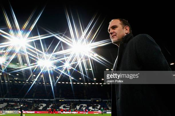 Manager Joerg Schmadtke of Hannover smiles prior to the UEFA Europa League Group L match between Hannover 96 and FC Twente at AWD Arena on November...