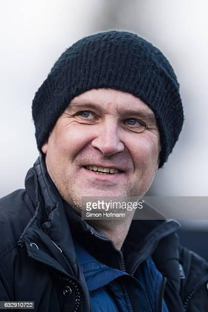 Manager Joerg Schmadtke of Koeln smiles prior to the Bundesliga match between SV Darmstadt 98 and 1 FC Koeln at JonathanHeimesStadion am...