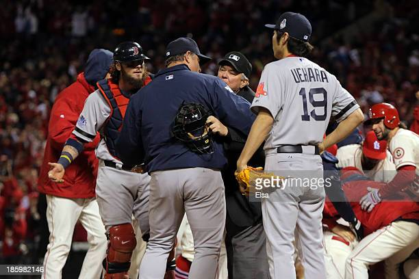 Manager John Farrell and Jarrod Saltalamacchia of the Boston Red Sox argue an obstruction call with Home Plate Umpire Dana DeMuth in the ninth inning...