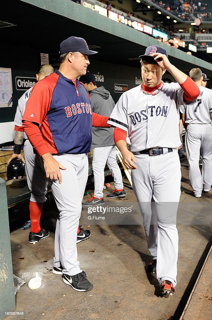 Manager John Farrell #53 and <a gi-track='captionPersonalityLinkClicked' href=/galleries/search?phrase=Junichi+Tazawa&family=editorial&specificpeople=4624306 ng-click='$event.stopPropagation()'>Junichi Tazawa</a> #36 of the Boston Red Sox in the dugout before the game against the Baltimore Orioles at Oriole Park at Camden Yards on September 27, 2013 in Baltimore, Maryland.