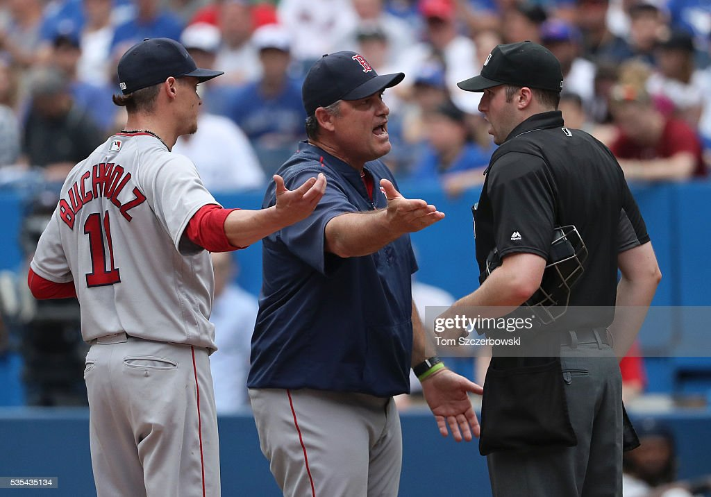Manager <a gi-track='captionPersonalityLinkClicked' href=/galleries/search?phrase=John+Farrell+-+Treinador+de+basebol&family=editorial&specificpeople=10307520 ng-click='$event.stopPropagation()'>John Farrell</a> #53 of the Boston Red Sox and <a gi-track='captionPersonalityLinkClicked' href=/galleries/search?phrase=Clay+Buchholz&family=editorial&specificpeople=4424901 ng-click='$event.stopPropagation()'>Clay Buchholz</a> #11 argue a hit-by-pitch call by home plate umpire Nic Lentz #59 which was overturned by video replay in the tenth inning during MLB game action against the Toronto Blue Jays on May 29, 2016 at Rogers Centre in Toronto, Ontario, Canada.
