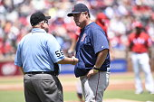Manager John Farrell of the Boston Red Sox argues a call at first base with umpire Eric Cooper during the game against the Texas Rangers at Globe...