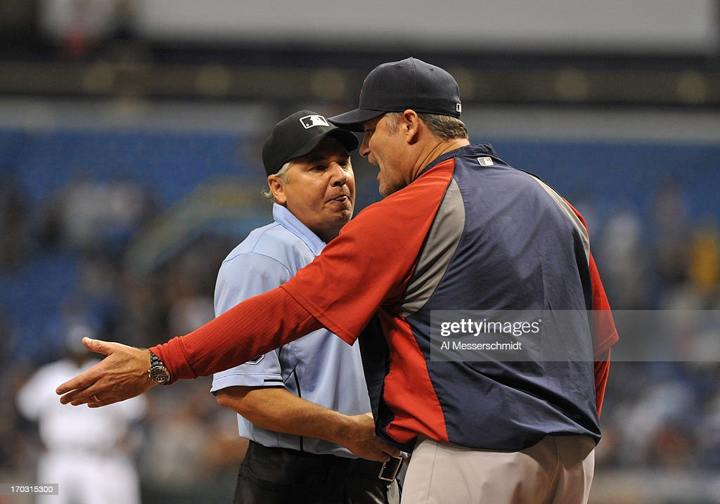 Manager John Farrell of the Boston Red Sox argues a call at home plate with umpire Tom Hallion during play against the Tampa Bay Rays June 10, 2013 at Tropicana Field in St. Petersburg, Florida. Boston won 10 - 8 in 14 innings.