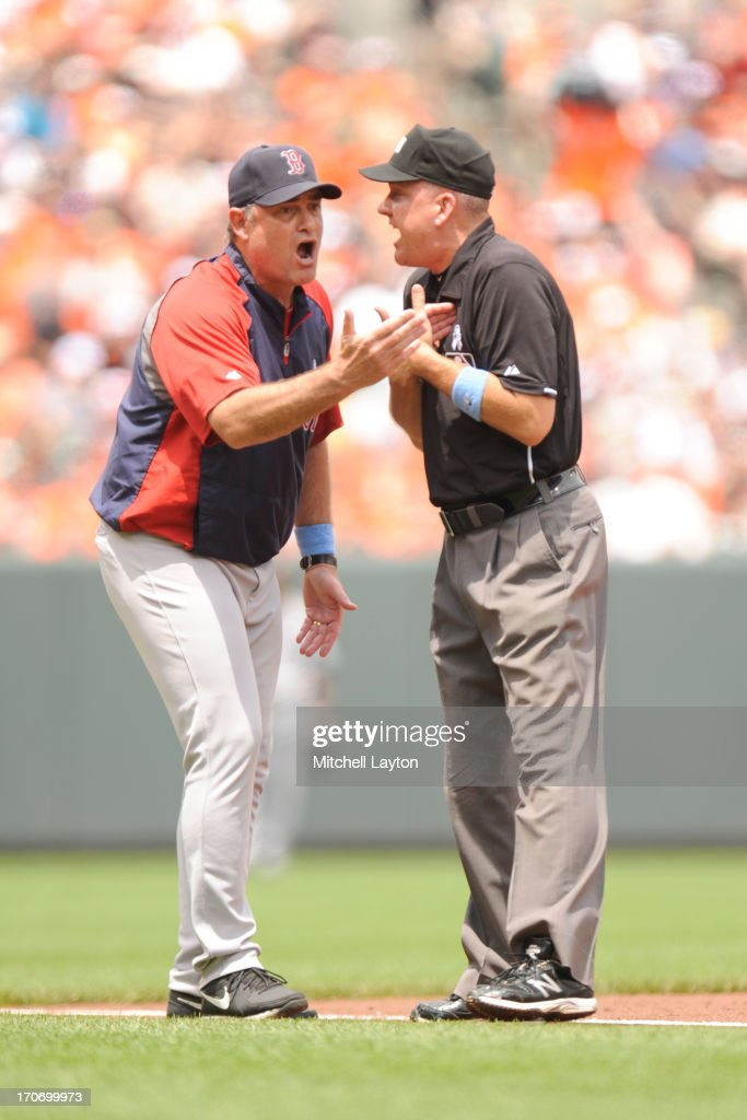Manager John Farrell #53 of the Boston Red Sox argues a call with umpire Jeff Nelson #45 during a baseball game against the Baltimore Orioles on June 16, 2013 at Oriole Park at Camden Yards in Baltimore, Maryland.