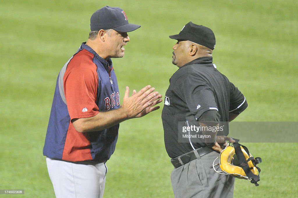 Manager John Farrell of the Boston Red Sox argues a call with umpire Laz Diaz during the sixth inning of a baseball game against the Baltimore...