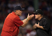 Manager John Farrell of the Boston Red Sox argues with first base umpire Jerry Meals during the eighth inning of a game against the Toronto Blue Jays...