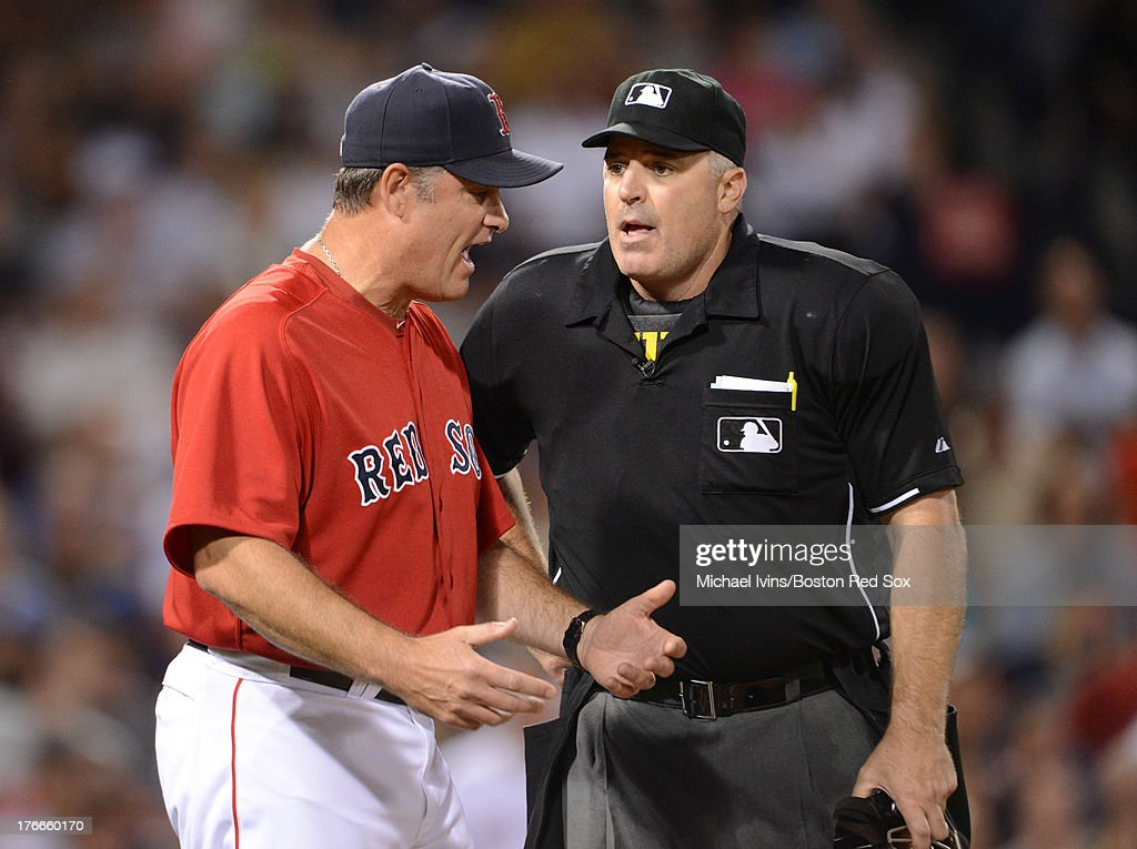 Manager John Farrell #53 of the Boston Red Sox argues with home plate umpire Bill Welke #52 after he made a call in favor of the New York Yankees in the seventh inning on August 16, 2013 at Fenway Park in Boston Massachusetts.