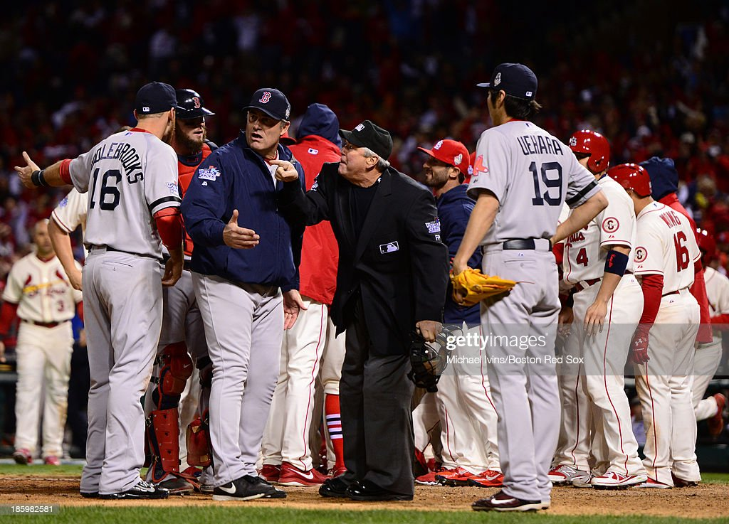 Manager John Farrell #53 of the Boston Red Sox argues with home plate umpire Dana DeMuth #32 after an interference call on <a gi-track='captionPersonalityLinkClicked' href=/galleries/search?phrase=Will+Middlebrooks&family=editorial&specificpeople=7934204 ng-click='$event.stopPropagation()'>Will Middlebrooks</a> #16 led to a 5-4 win by the St. Louis Cardinals in Game Three of the 2013 World Series on October 26, 2013 at Busch Stadium in St. Louis, Missouri.