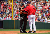 Manager John Farrell of the Boston Red Sox argues with umpire Jeff Kellogg after Edwin Encarnacion of the Toronto Blue Jays slid into Xander Bogaerts...