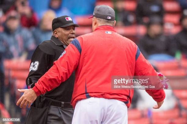 Manager John Farrell of the Boston Red Sox argues with umpire Laz Diaz during the seventh inning of a game against the Tampa Bay Rays on May 14 2017...