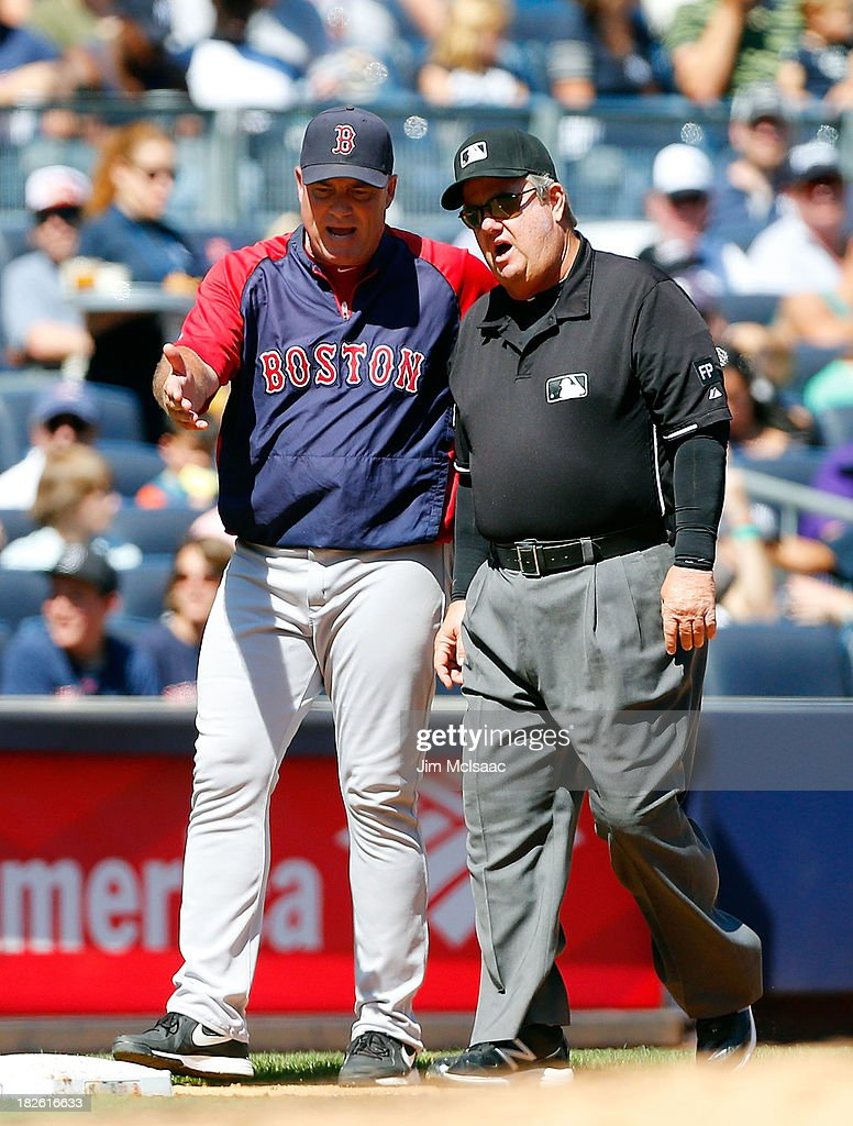 Manager John Farrell of the Boston Red Sox argues you a call against the New York Yankees with third base umpire Joe West at Yankee Stadium on...